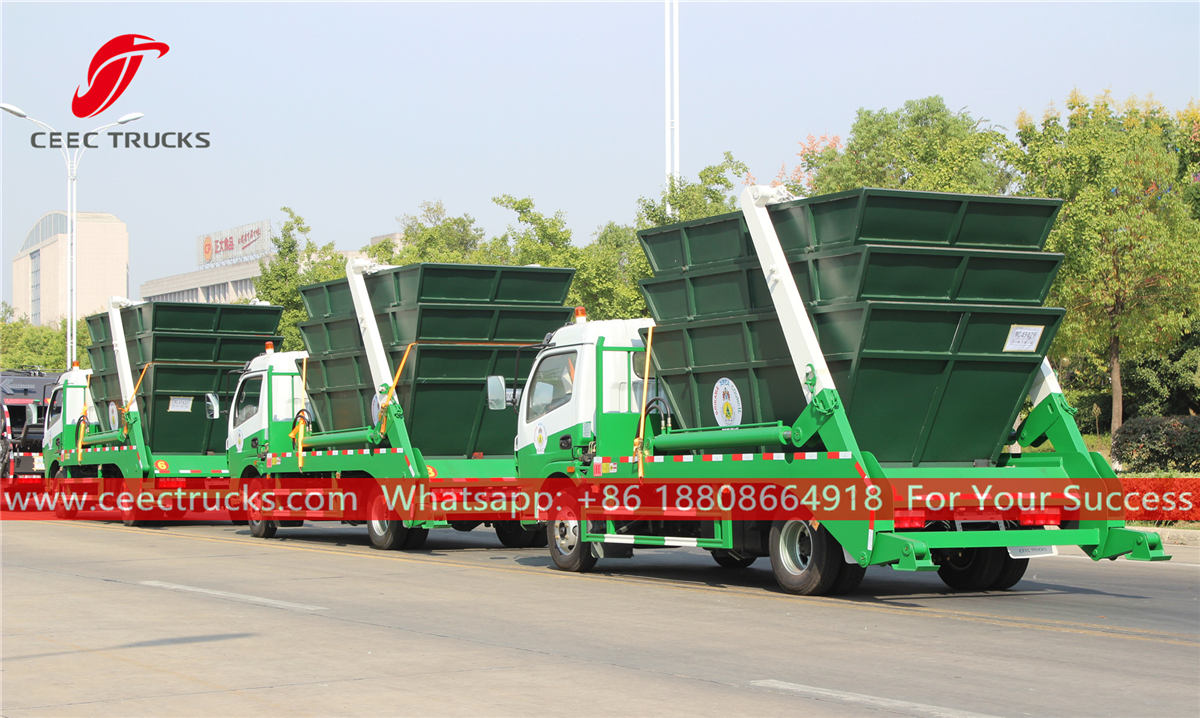 Swing arm garbage trucks with bins
